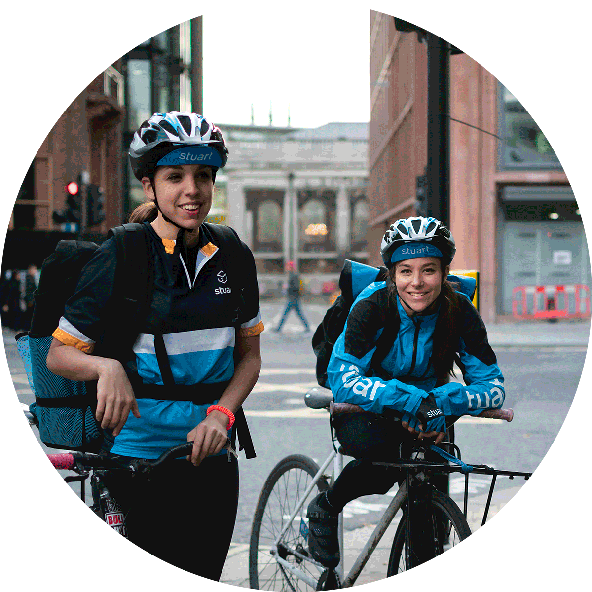 Two smiling female cyclists enjoy a break from Stuart courier life