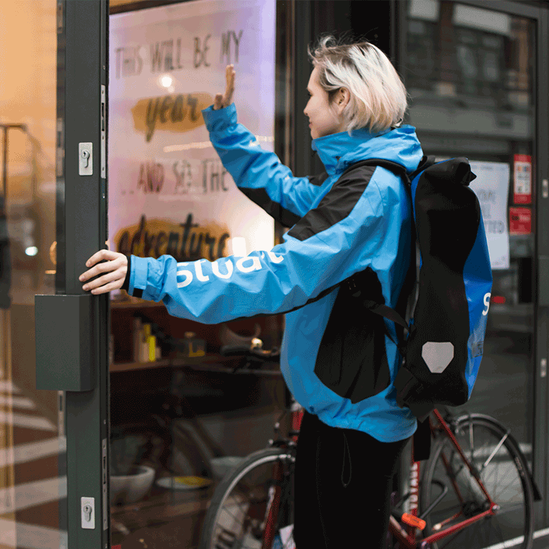 woman courier waving
